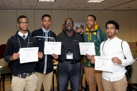 chris with students showing certificates